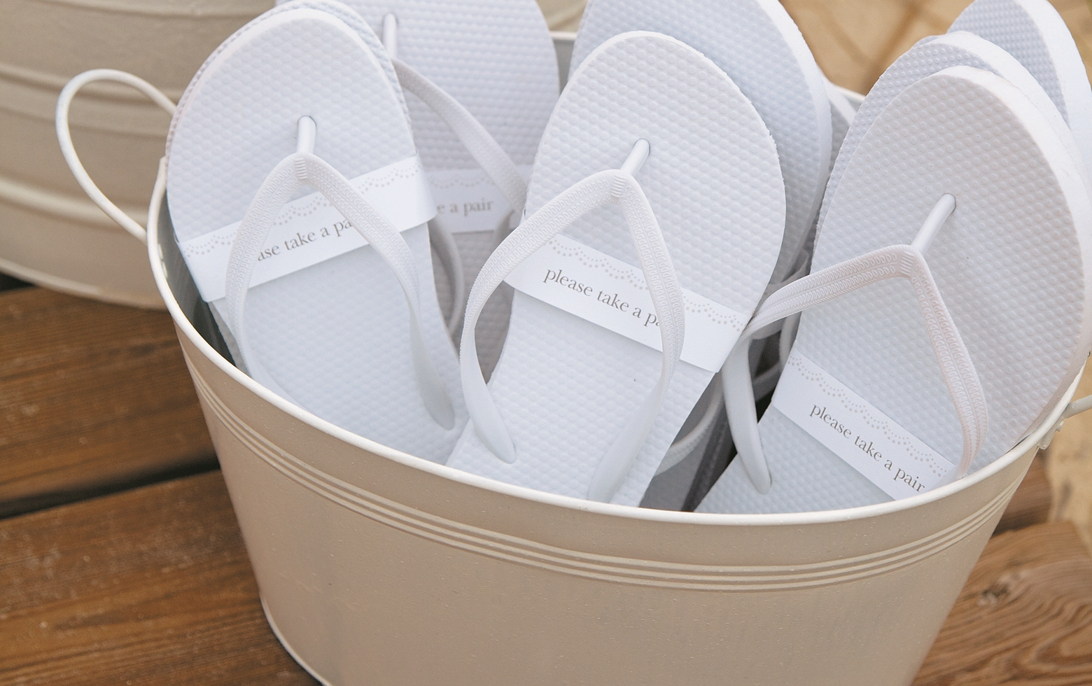 e0e44d993e103e All you need is a bucket and white flip flops! Talk to your wedding planner  about incorporating a flip flop station into your special day!