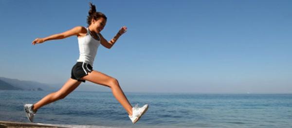 women sprinting on beach