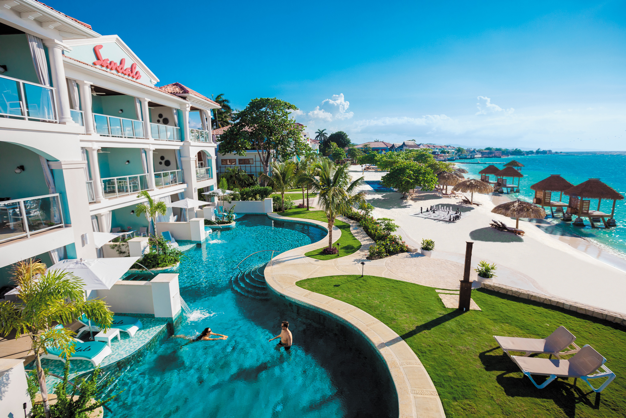 Real love stories told at Sandals Montego Bay. Pictured: Lagoon pool and beachfront swim-up suites