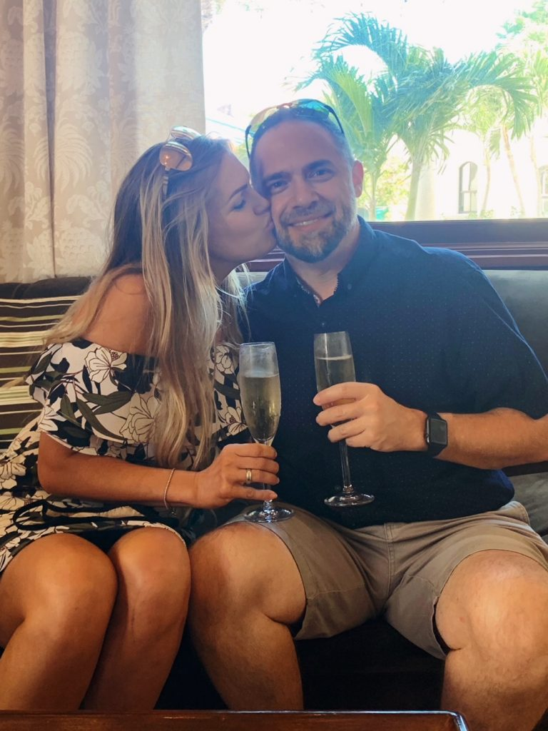 Test Drive Your WeddingMoon® couple celebrates with glasses of champagne
