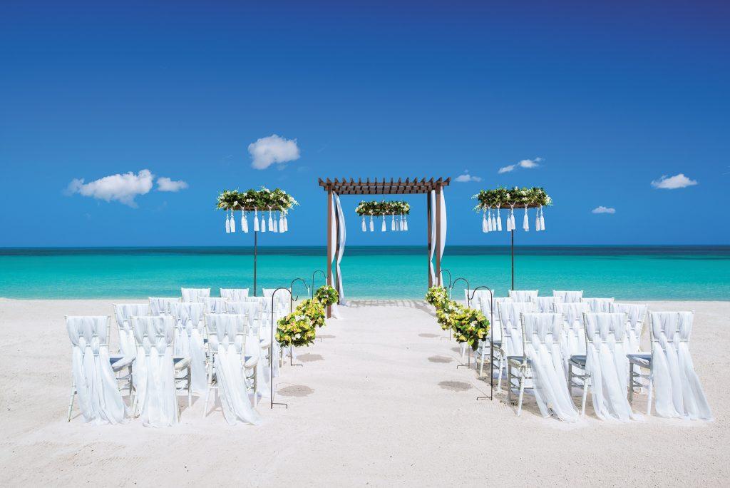 beachfront ceremony setup with simple yet elegant features