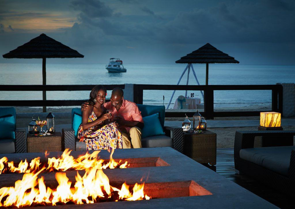 Couple enjoys an evening beside a fire pit