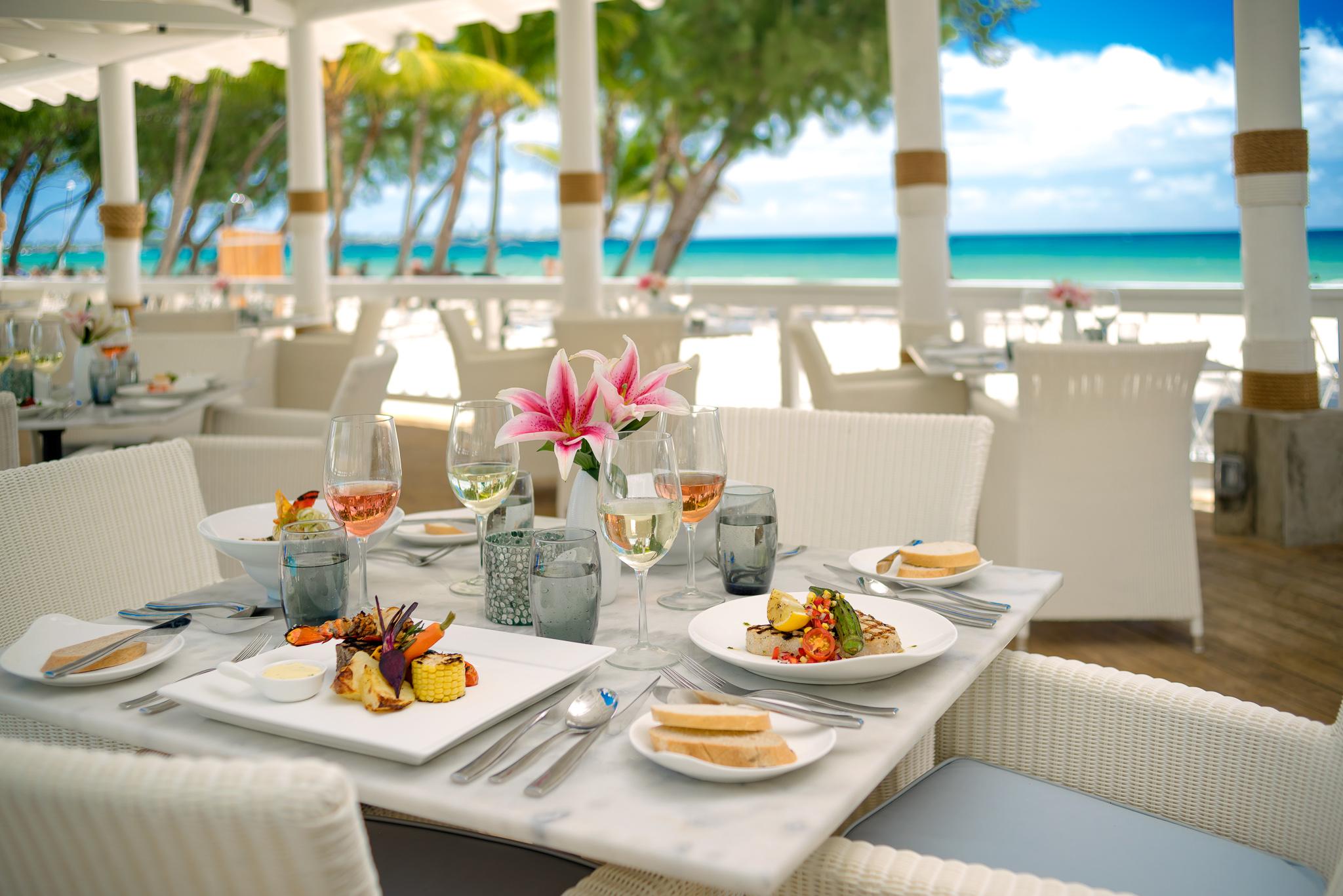 A delicious spread of food set near the Caribbean Sea.