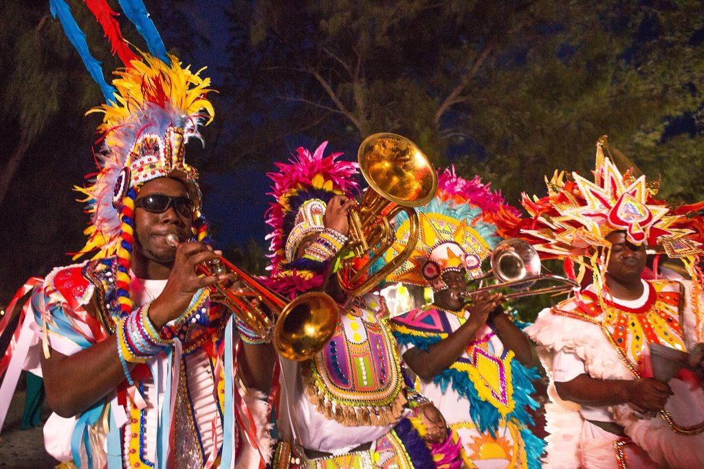 Bright, colorful Junkanoo band performs at night
