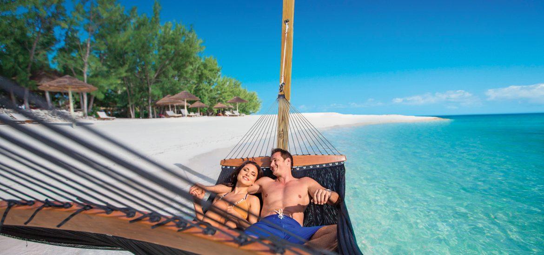 Couple on a hammock, choosing The Bahamas for their honeymoon destination