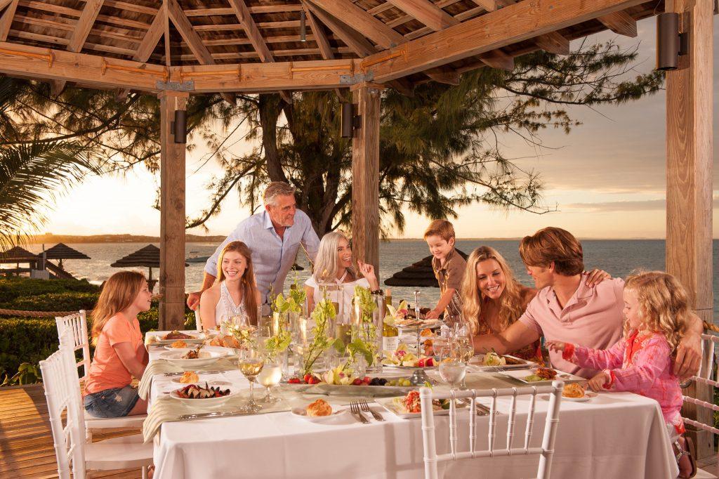 Family enjoy ocean view dinner setting