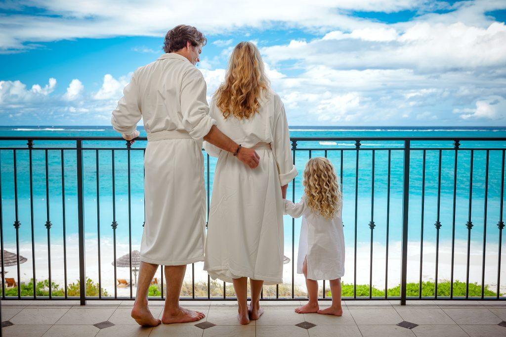 Family enjoys ocean balcony views at Beaches Resorts