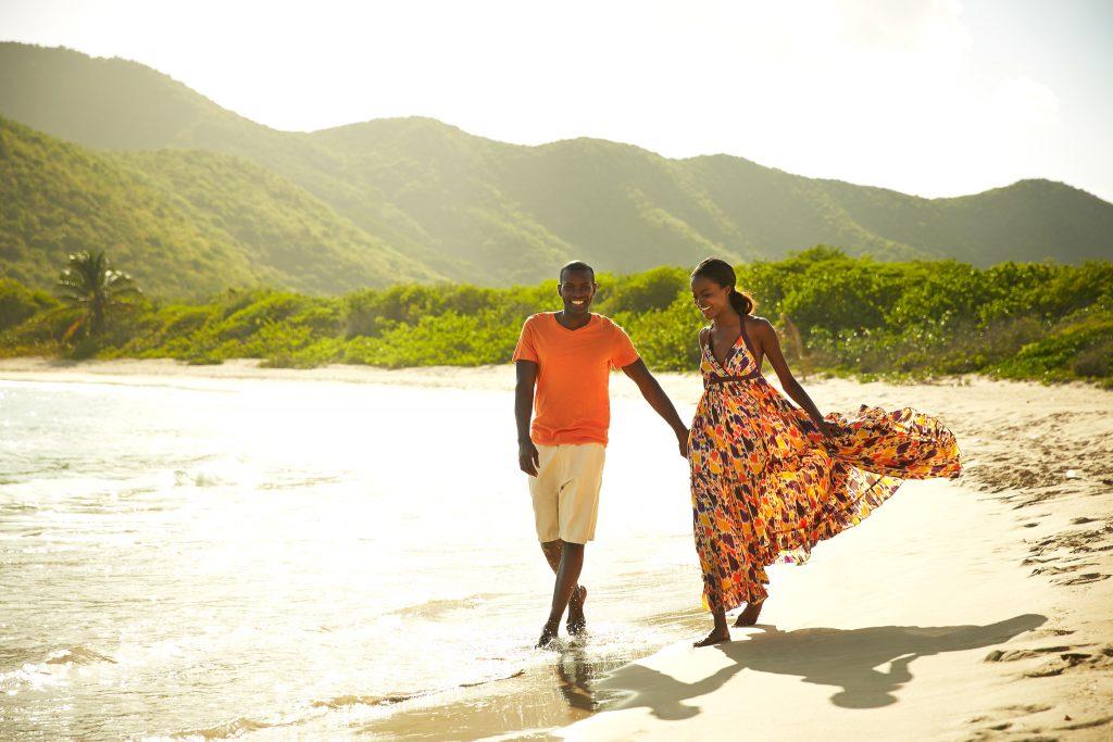 Couple strolls along the beach