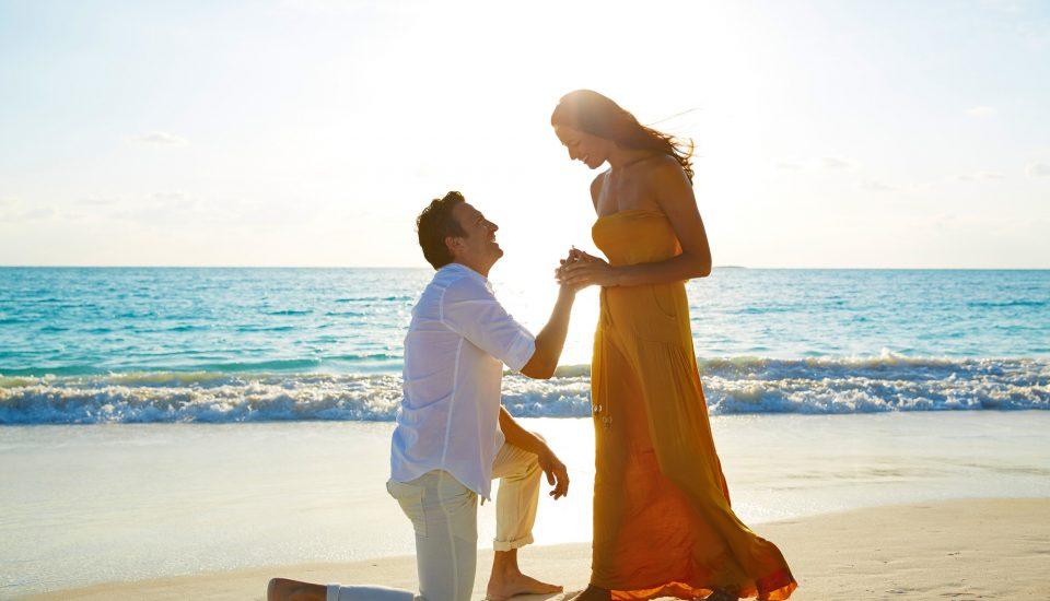 Destination proposal on a beach at golden hour.