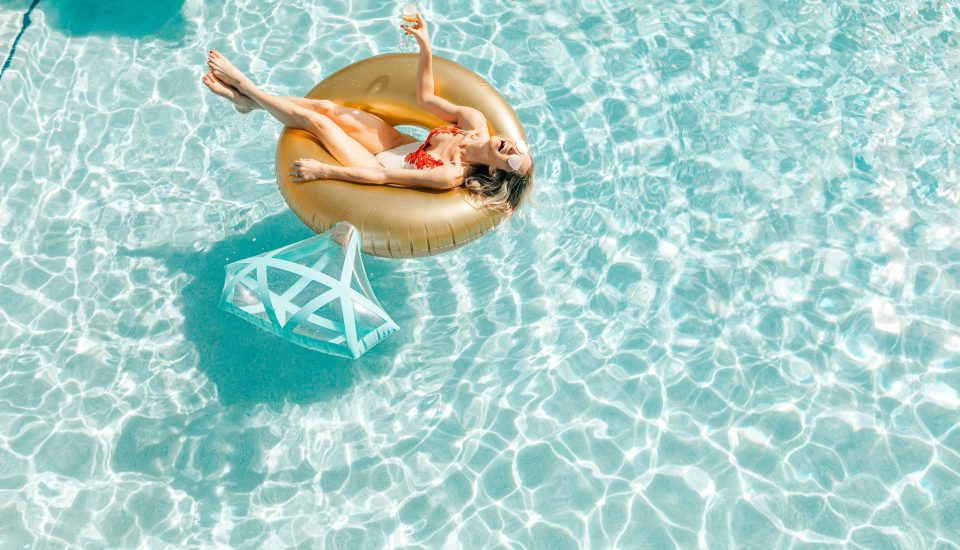 Bride floats in a pool at Beaches Turks & Caicos, the ultimate bachelorette party destination.