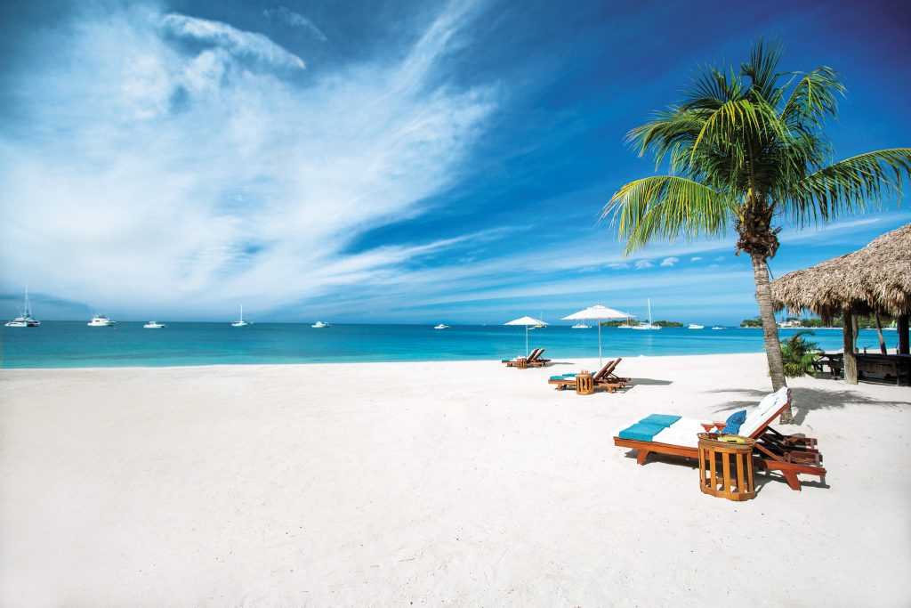 Negril's white sand beaches and turquoise waters make for the perfect post-pandemic wedding locale