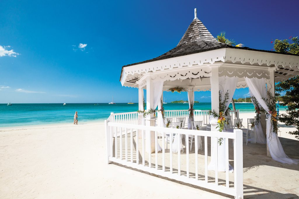 Beachfront wedding gazebo makes for a breathtaking backdrop.