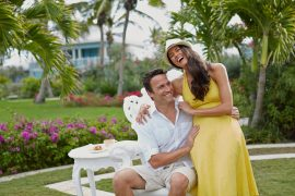 Couple enjoying a fun-filled moment together. The bride is wearing one Pantone Color of the Year - Illuminating Yellow