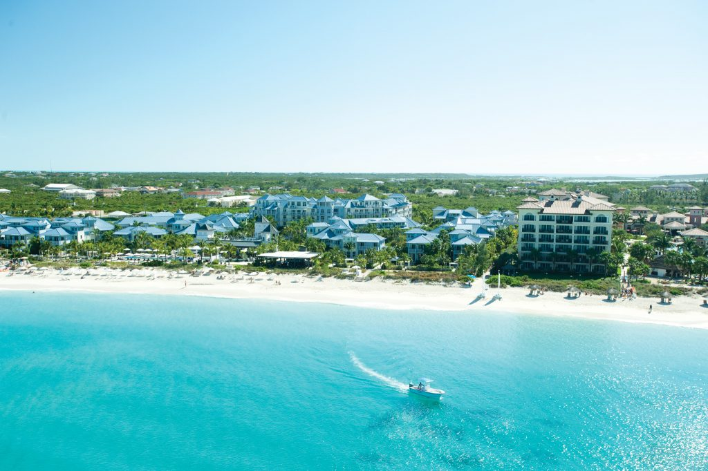 View of the 12 mile beach, turquoise blue waters, and Key West Village at Beaches Turks & Caicos.
