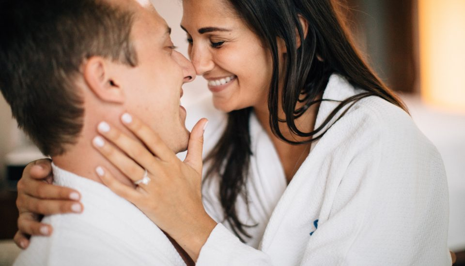 Couples embraces during a romantic stay at Sandals Resorts