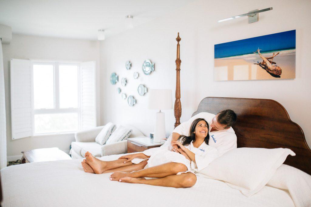 Couple cozies up in bathrobes to celebrate their honeymoon.